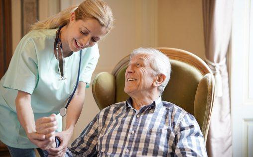 Nurse checking senior man blood pressure