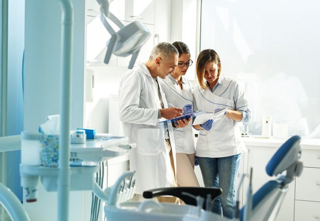 Medical dentist team in dental office discuss about practice and